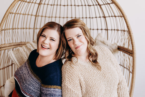 Leslie and Stacey Malmgren, owners of Love Marlow Boutique in Sioux Falls SD, smile for a photo wearing sweaters from their new fall line of Plus Size Clothes.