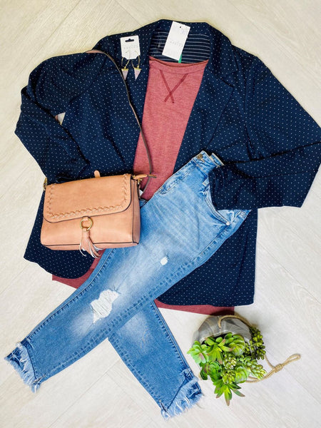 flat lay display of a blue blazer, dusty rose top and distressed skinny jeans. A zoom call outfit inspiration for plus size women.