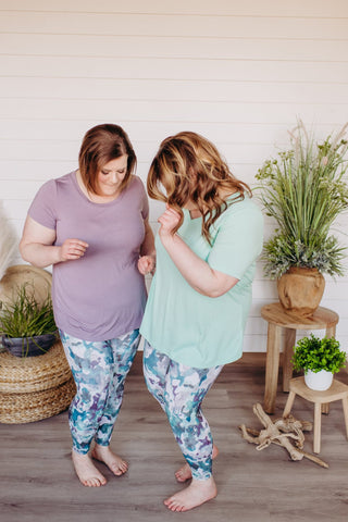 Owners of Love Marlow Boutique in Sioux Falls dance in matching spanx blue camo leggings.