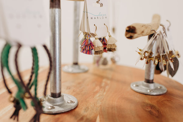 Love Marlow Boutique on Lake Lorriane in Sioux FAlls South Dakota displays accessories and jewelry using driftwood holders.
