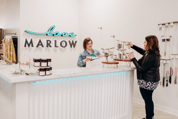 Stacey and Leslie Malmgren, owners of Love Marlow Boutique in Sioux Falls SD, stand by the register surveying their new inventory of jewerly.