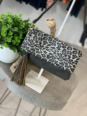 ANIMAL PRINT FOLD OVER CLUTCH WITH TASSEL DETAIL