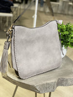 CROSSBODY SATCHEL WITH WHIP STITCH AND TASSEL DETAIL