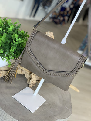 ENVELOPE STYLE CROSSBODY CLUTCH WITH WHIP-STITCH AND TASSEL DETAILS