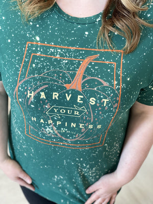 "Close up of plus size graphic tee with a pumpkin that says, ""Harvest your happiness."""