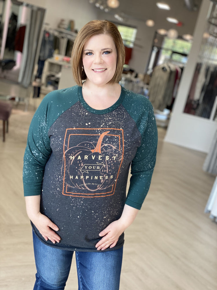 "Plus size graphic tee with raglan style sleeveswith a pumpkin that says, ""Harvest your happiness."""