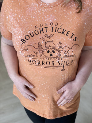 """NOBODY BOUGHT TICKETS TO SEE YOUR HORROR SHOW"" GRAPHIC TEE"