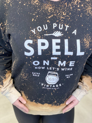 """YOU PUT A SPELL ON ME NOW LET'S WINE"" GRAPHIC SWEATSHIRT"