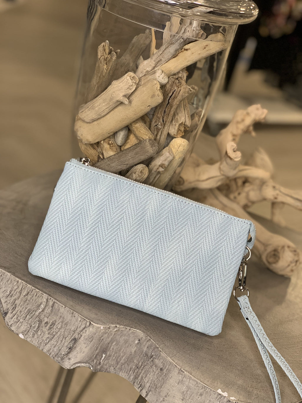 WOVEN FAUX LEATHER CLUTCH