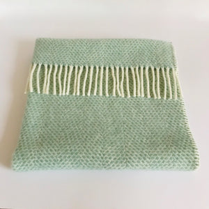 Rory & Ruby pure new wool baby pram blanket in ocean aqua with cream woollen tassel fringe and blanket stitch edging.