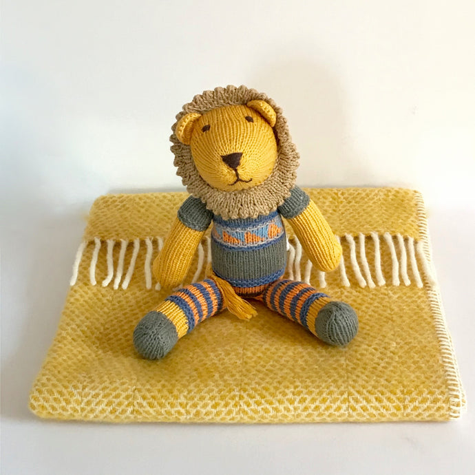 Rory & Ruby pure new wool baby blanket in beehive gold with organic cotton hand knitted lion soft toy with fair isle jumper and stripy legs.