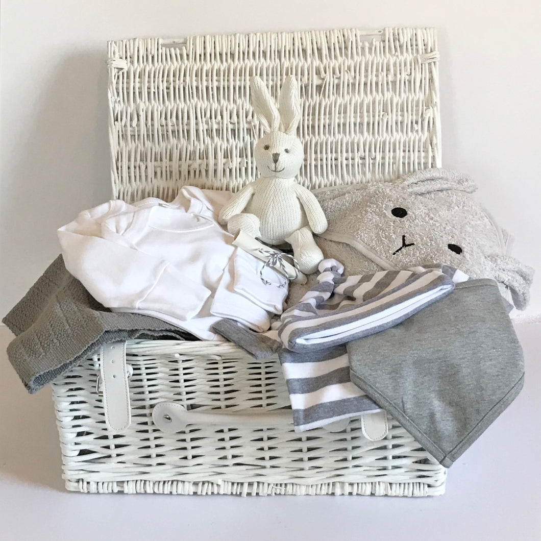 Rory & Ruby luxury new baby bunny hamper with eight organic and eco-friendly gifts in pure white and stylish grey beautifully wrapped in a white wicker hamper.