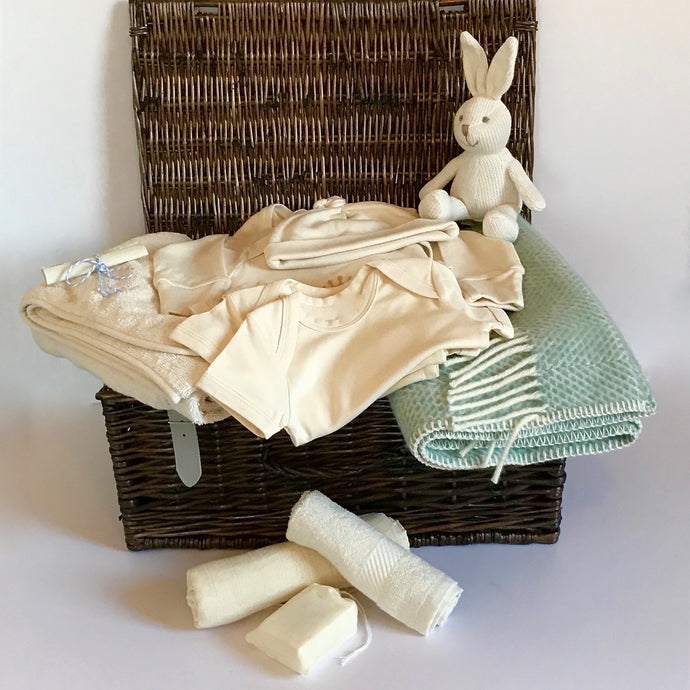 Rory & Ruby luxury baby hamper filled with organic and eco-friendly welcome to the world gifts with ocean aqua pure new wool pram blanket.
