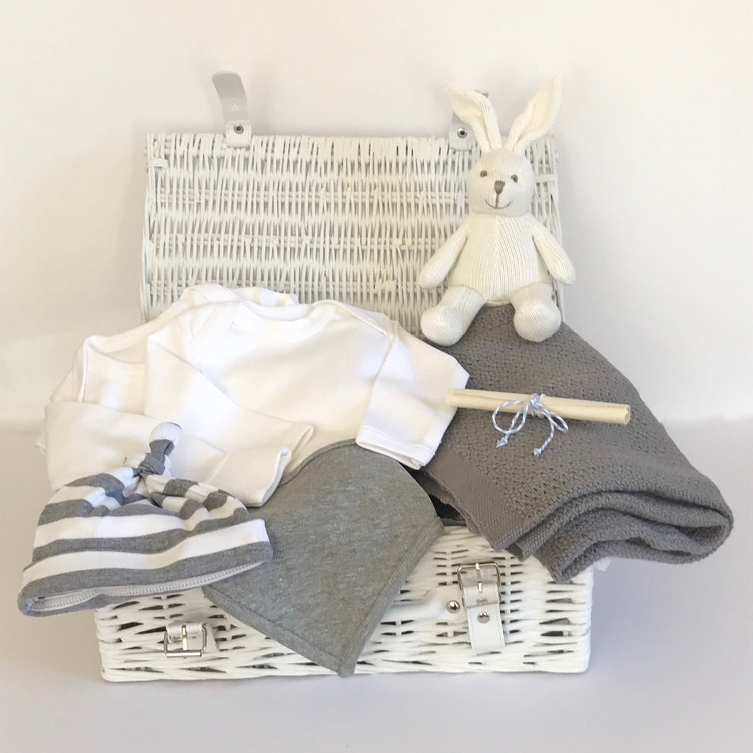 Rory & Ruby new baby bunny hamper with six organic and eco-friendly gifts in pure white and stylish grey beautifully wrapped in a white wicker hamper.