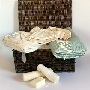 Rory & Ruby celebration baby hamper filled with organic and eco-friendly welcome to the world gifts with ocean aqua pure new wool pram blanket.