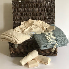 Load image into Gallery viewer, Rory & Ruby celebration baby hamper filled with organic and eco-friendly welcome to the world gifts with sky blue pure new wool pram blanket.