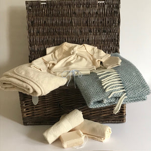 Rory & Ruby celebration baby hamper filled with organic and eco-friendly welcome to the world gifts with sky blue pure new wool pram blanket.