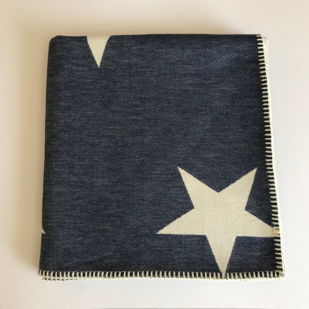 Rory & Ruby reversible star design throw in navy and ivory with traditional blanket stitch edging.