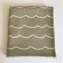 Load image into Gallery viewer, Rory & Ruby reversible wave design throw in sand and ivory with traditional blanket stitch edging.