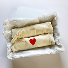 Load image into Gallery viewer, Rory & Ruby long sleeve organic cotton baby sleepsuits with gold crown and red love heart embroidery in gift box.