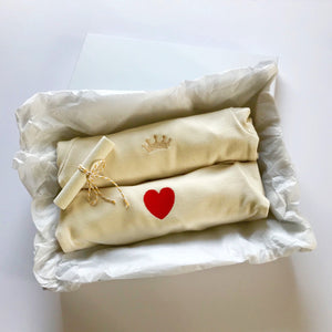 Rory & Ruby long sleeve organic cotton baby sleepsuits with gold crown and red love heart embroidery in gift box.