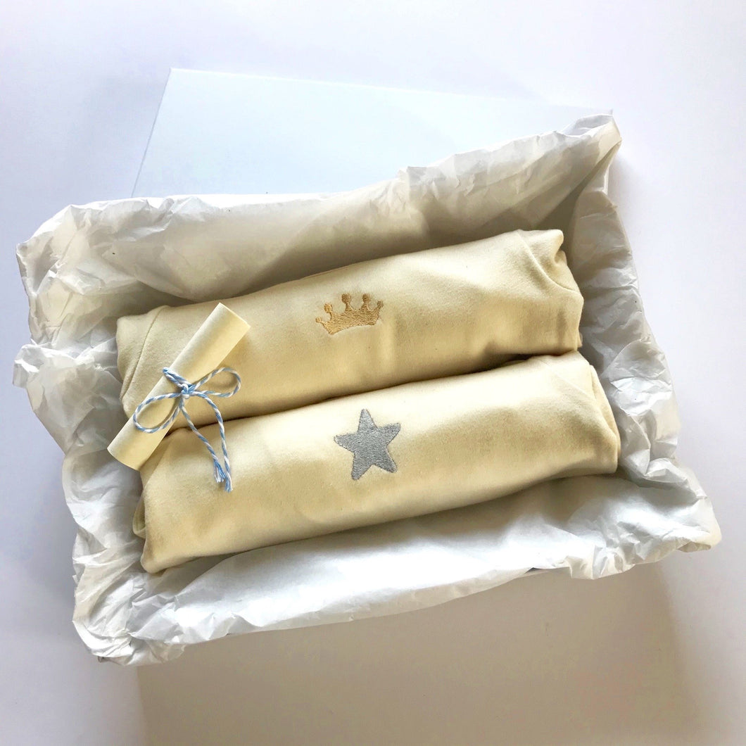 Rory & Ruby long sleeve organic cotton baby sleepsuits with gold crown and silver star embroidery in gift box.