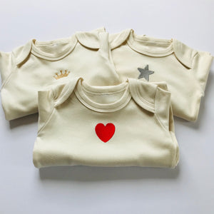 Rory & Ruby long sleeve organic cotton baby sleepsuits with a choice of three unique embroidered designs on the front.