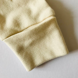Rory & Ruby long sleeve organic cotton sleepsuit cuff mitt to prevent baby scratching.