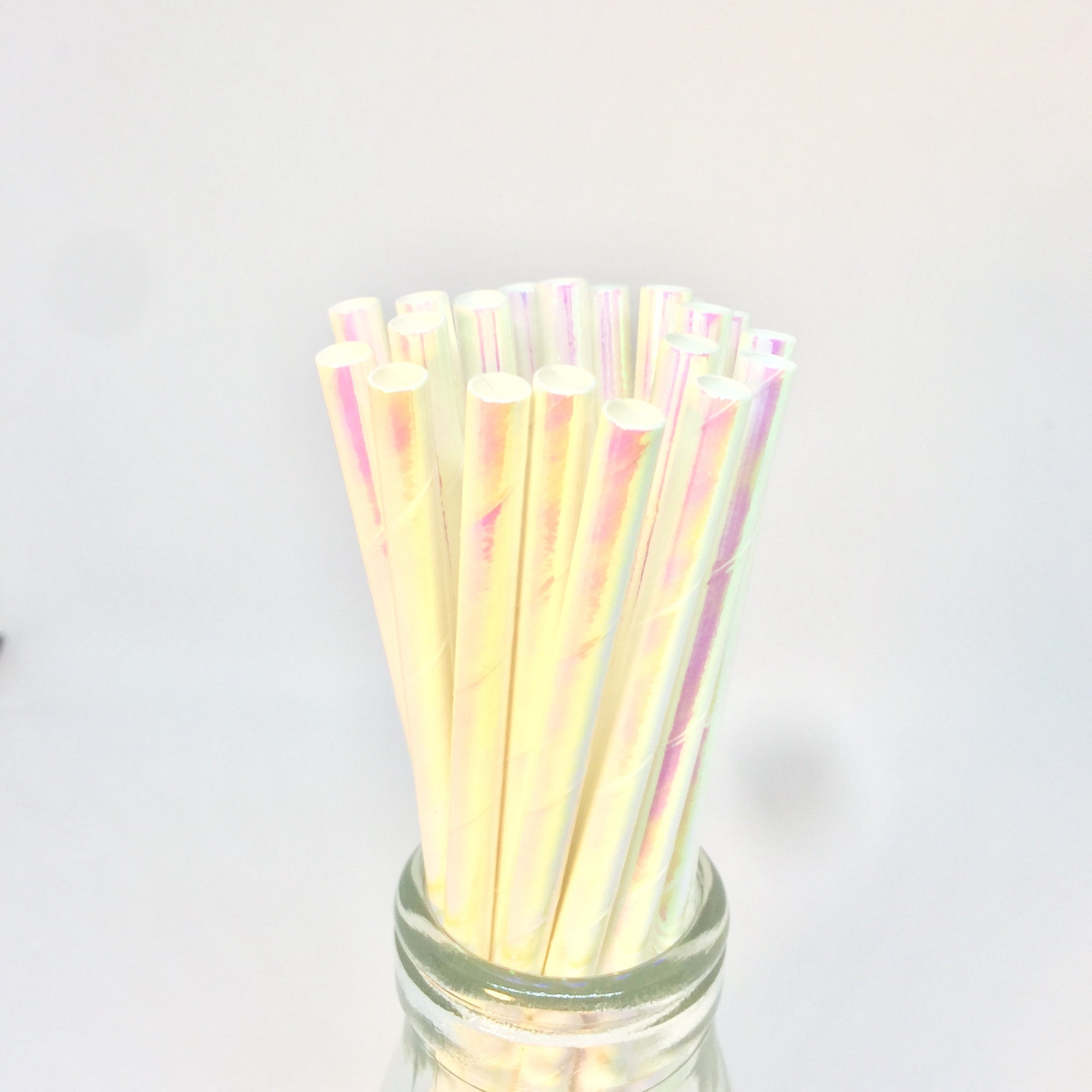 white iridescent straws