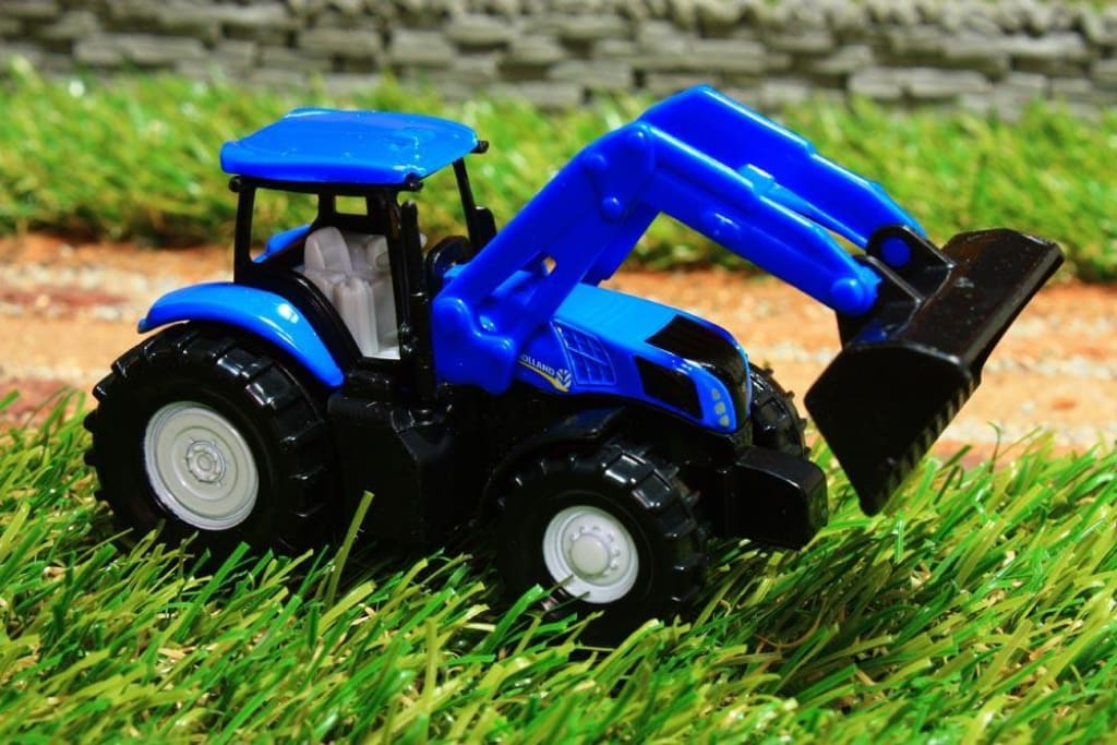 1355 SIKU 187 SCALE NEW HOLLAND TRACTOR WITH LOADER