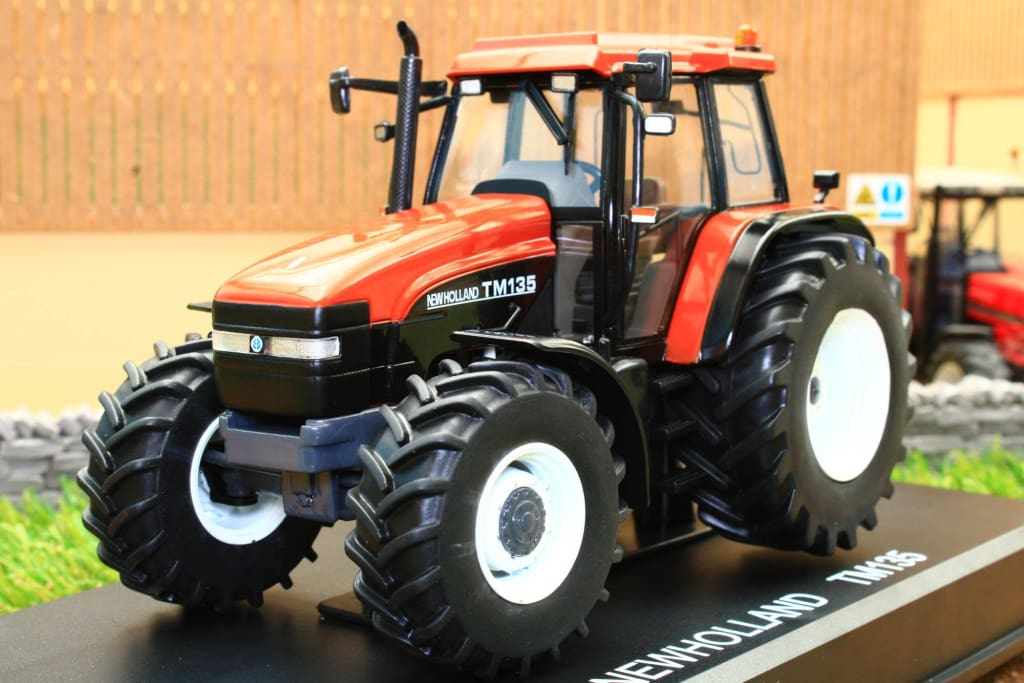 REP221 REPLICAGRI NEW HOLLAND TM135 TRACTOR IN TERRACOTA