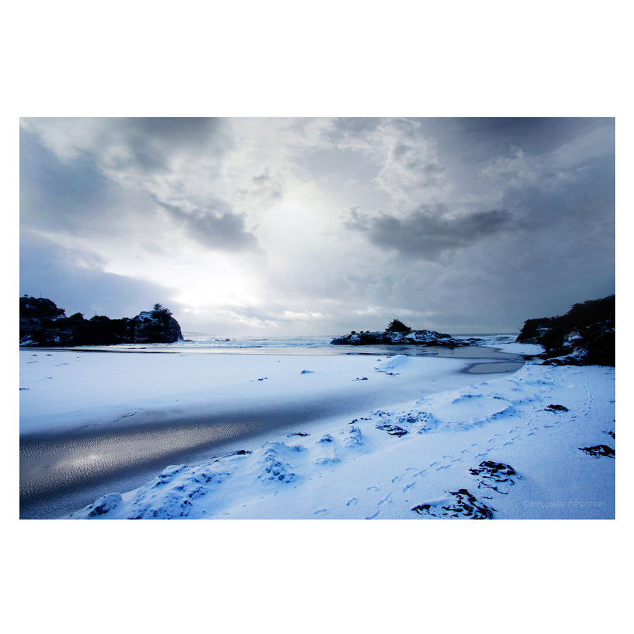 Photo of brighton beach covered in snow, dunedin, new zealand photo