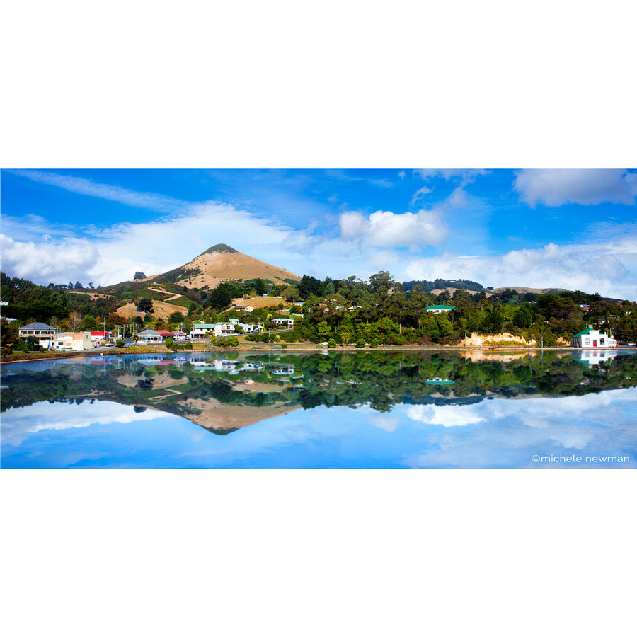 Photo of portobello reflection with harbour cone, otago peninsula harbour dunedin new zealand