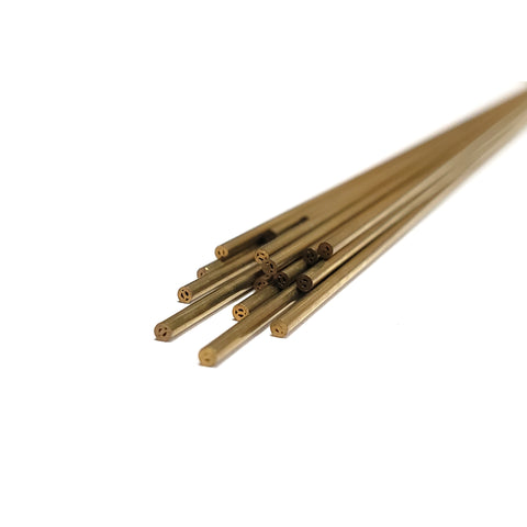 Front view of twenty 1.4mm metric brass electrodes.