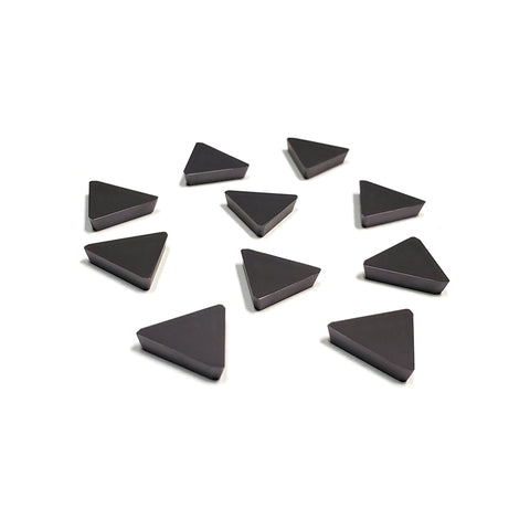 Front view of ten triangular milling inserts for steel.