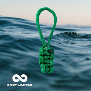 Knot in the Ocean Whatknot made from recycled ocean plastic on ocean background