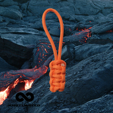 Load image into Gallery viewer, Knot Limited Magma Whatknot on flowing lava flow background