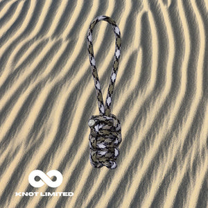Knot Limited Snake Camo Whatknot on Sand Background