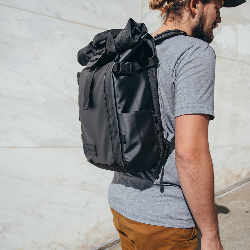 WANDRD PRVKE 31L Black on the back of a man