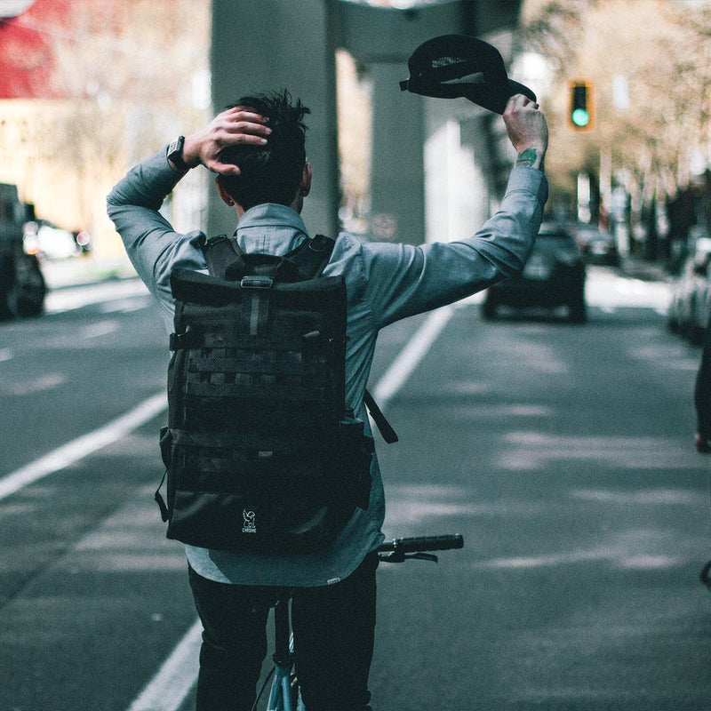 Chrome Industries Barrage Cargo on a man riding a bike
