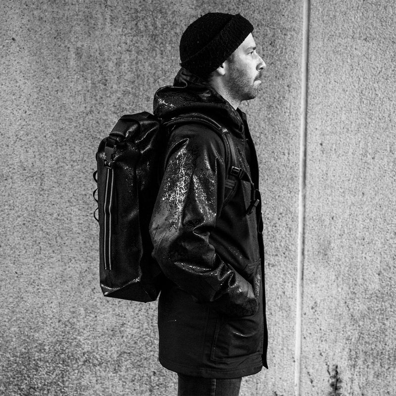 Chrome Industries Urban Ex 2.0 Rolltop 30L on man from side