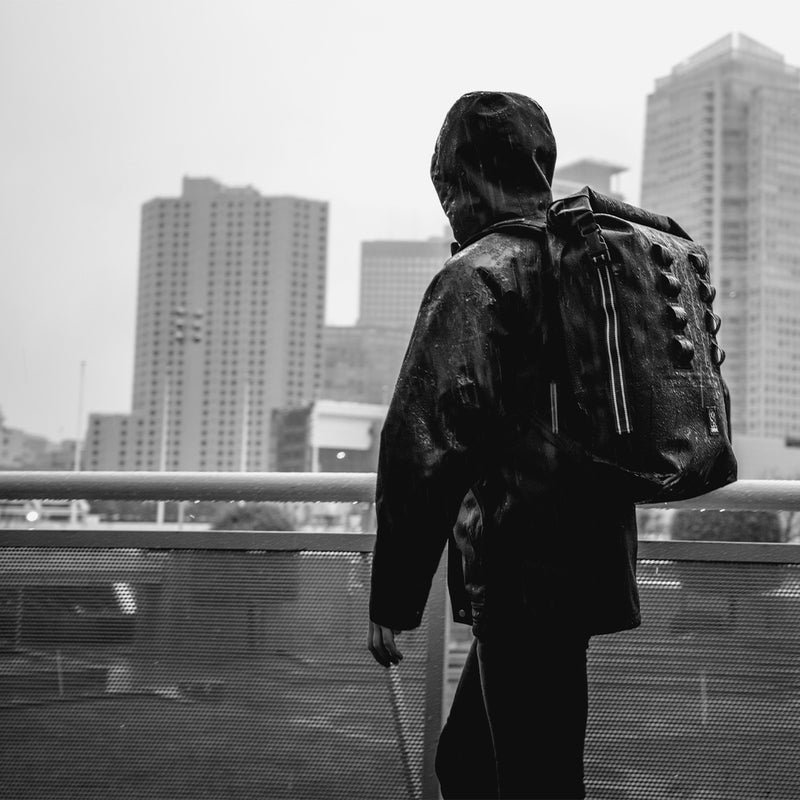 Chrome Industries Urban Ex 2.0 Rolltop 30L on man under rain