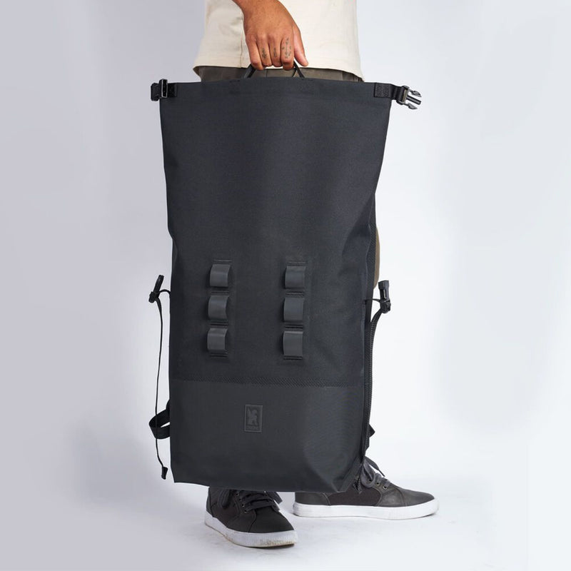 Chrome Industries Urban Ex 2.0 Rolltop 30L handled by man