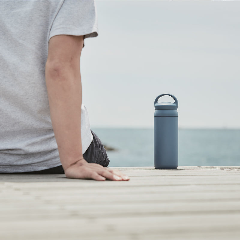 Kinto Day Off Tumbler Navy on front of the sea