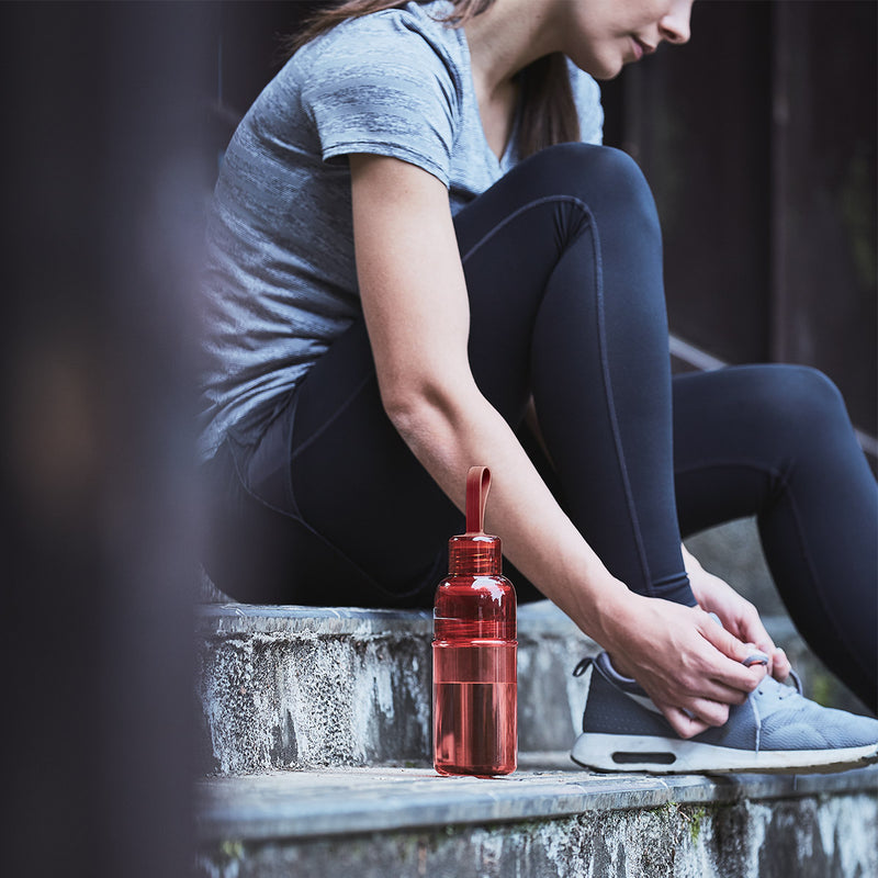 Kinto Workout Bottle Red on stairs