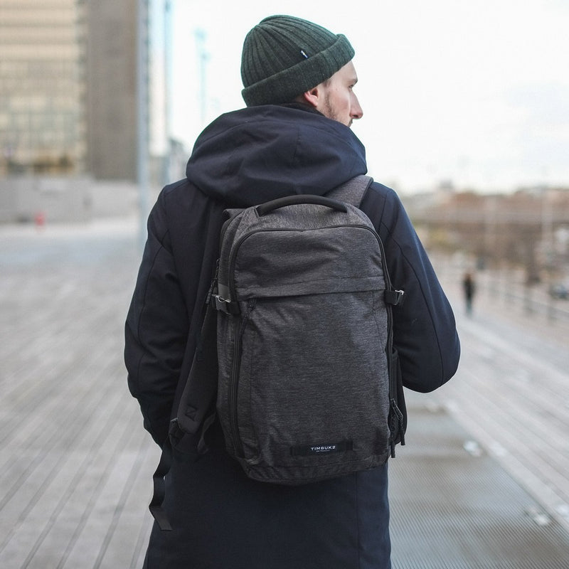 Man walking with TImbuk2 Division Jet Black Static