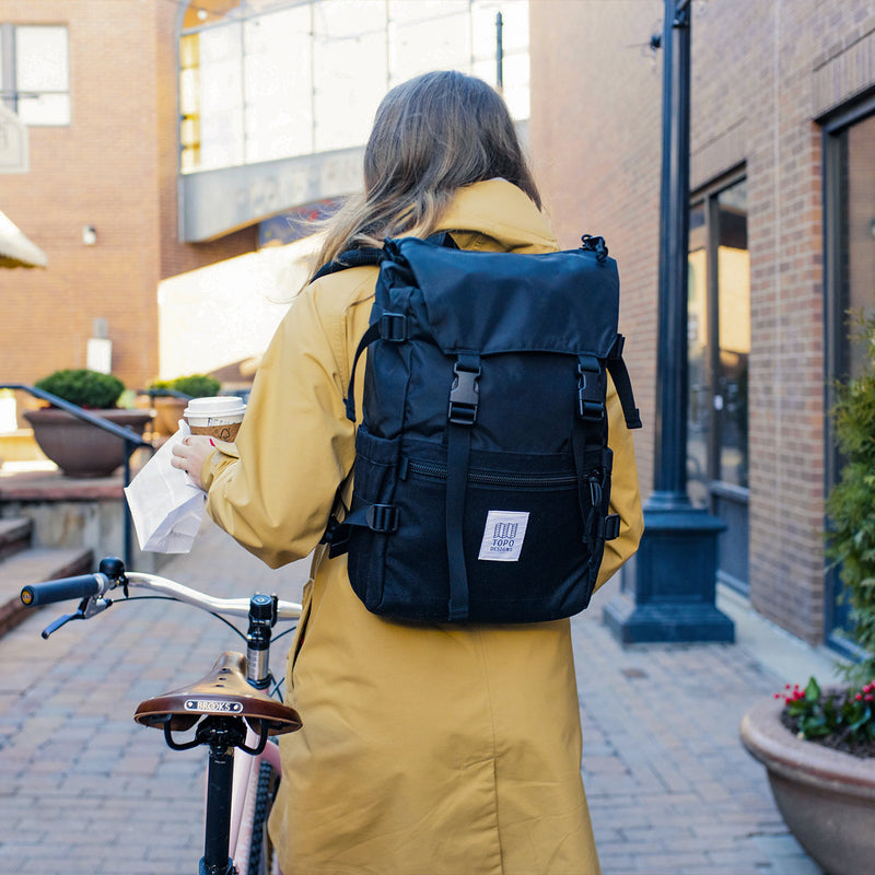 Topo Designs Rover Pack Black on woman with bike