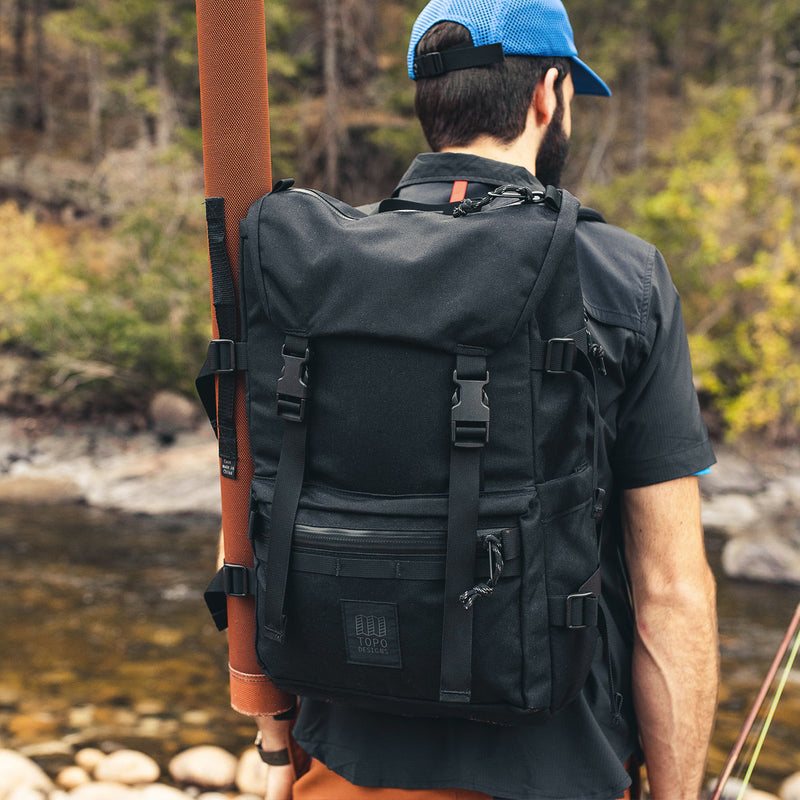Topo Designs Rover Pack Tech Black on man in forest