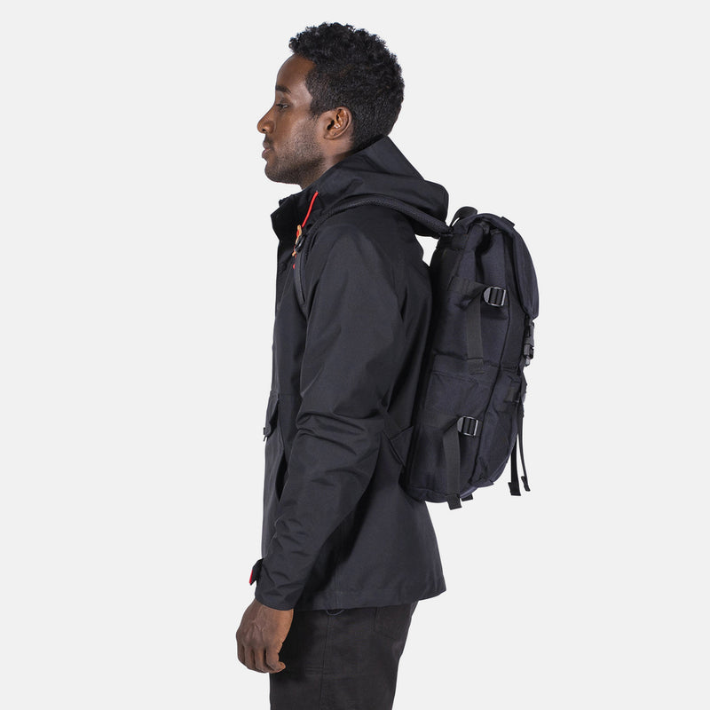Topo Designs Rover Pack Tech Black on man side view