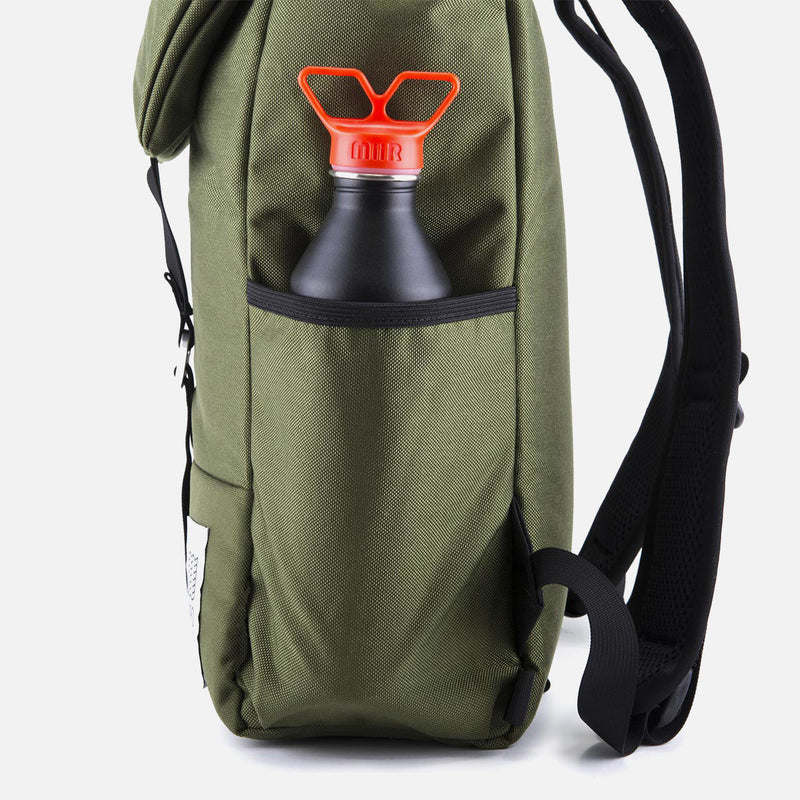 Topo Designs Y Pack Olive side with a bottle in the pocket